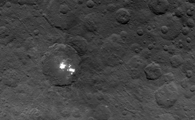 The brightest of the bright spots on Ceres, in Occator crater. Haze detected above them may help scientists determine if they are made of ice, salts or something else. Photo Credit: NASA/JPL-Caltech/UCLA/MPS/DLR/IDA