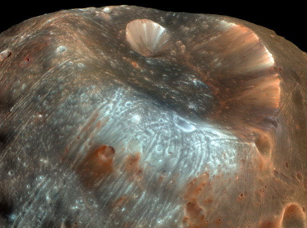 The unusual grooves on Phobos' surface, such as those on the left side of this image, are now thought to be caused by tidal stress. The large crater Stickney is in the upper portion of the image. Image Credit: NASA/JPL-Caltech/University of Arizona
