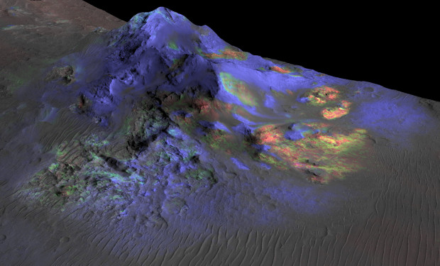 Image from the Compact Reconnaissance Imaging Spectrometer for Mars (CRISM) instrument on the Mars Reconnaissance Orbiter, showing deposits of impact glass (green) in Alga Crater. Image Credit: NASA/JPL-Caltech/JHUAPL/Univ. of Arizona