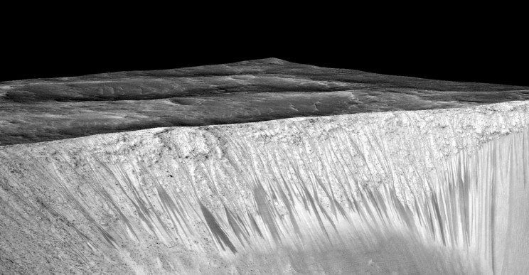 RSL emanating out of the walls of Garni crater. The streaks are narrow, but up to several hundred meters in length. Image Credit: NASA/JPL/University of Arizona