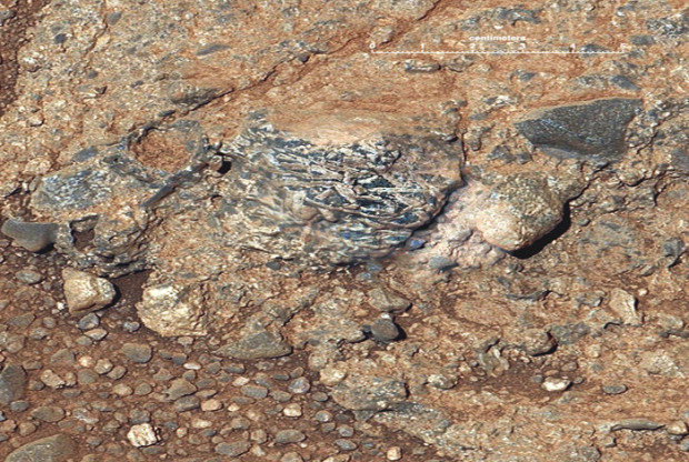 View of an igneous clast named Harrison which is embedded in a conglomerate rock in Gale crater, and features elongated light-toned feldspar crystals. This mosaic is a combination of an image from Mastcam with higher-resolution images from ChemCam's Remote Micro-Imager. Photo Credit: NASA/JPL-Caltech/LANL/IRAP/U. Nantes/IAS/MSSS