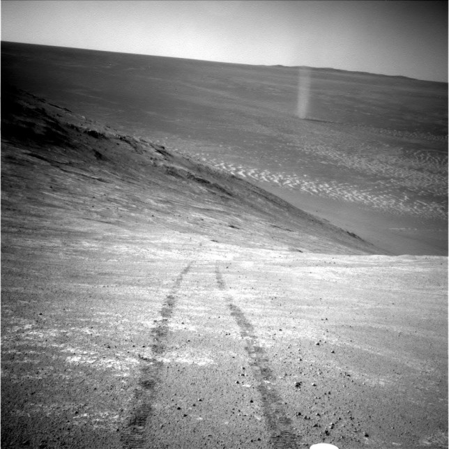 Dust devil seen by Opportunity on sol 4332 inside Endeavor crater. While not many dust devils have been seen by Opportunity, many had been imaged by its twin rover Spirit, in Gusev crater. Photo Credit: NASA/JPL-Caltech