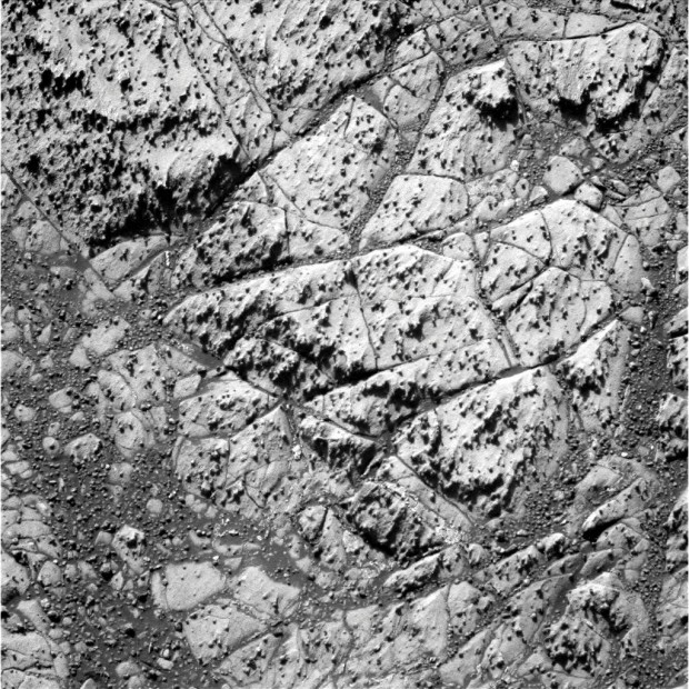 "A Pancam image from sol 3212 showing the ""newberries"" covering slabs of bedrock. Click for larger version. Credit: NASA / JPL-Caltech."