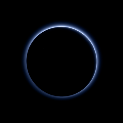 "The ""blue skies of Pluto"" as seen by New Horizons after closest approach, one of the most iconic images of the mission. Soot-like particles in the atmosphere scatter sunlight in a way that the atmosphere appears blue. This backlit view of Pluto can never be seen from Earth. Photo Credit: NASA/JHUAPL/SwRI"