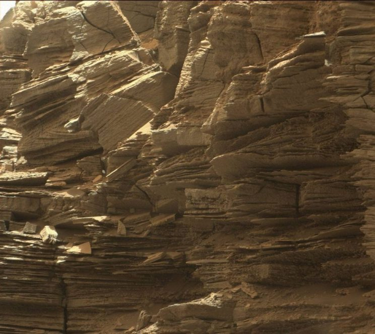 The finely layered buttes seen by Curiosity record a long history of changing environmental conditions. Photo Credit: NASA/JPL-Caltech