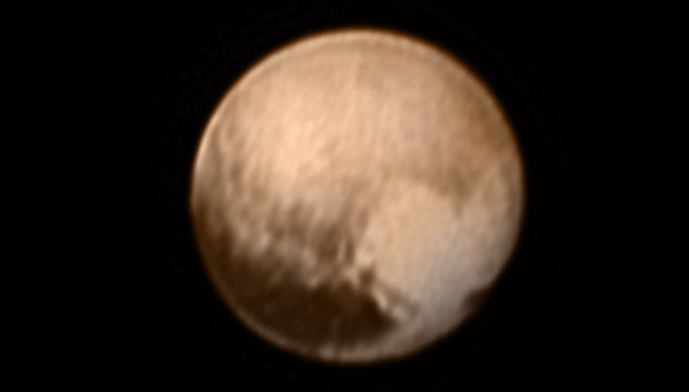 """The newest image of Pluto, taken by New Horizons' Long Range Reconnaissance Imager (LORRI) camera less than six days before closest approach. The long dark area called the """"whale"""" is in the lower left and the brighter """"heart"""" region is in the lower right. Image Credit: NASA/JHUAPL/SWRI"""