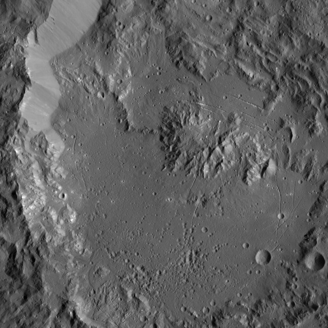 This view of Ikapati crater, with peaks and roughly parallel fractures, provides additional evidence for geological activity on Ceres. Photo Credit: NASA/JPL-Caltech/UCLA/MPS/DLR/IDA