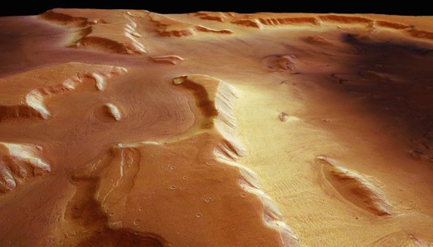 Image of dust-covered glaciers on Mars from the High Resolution Stereo Camera on Mars Express. The glaciers are composed of water ice. Image Credit: ESA/DLR/FU Berlin