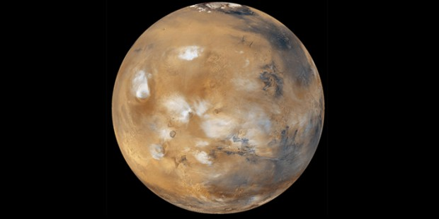 Mars' atmosphere is much thinner now than it once was, but it still has clouds, as seen in this NASA photo, as well as fog, wind, dust storms, and snow. Credit: NASA / JPL