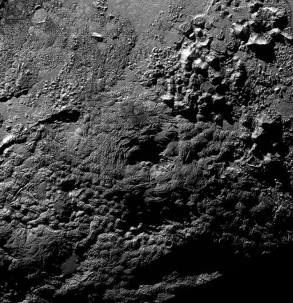 Wright Mons, which is now suspected of being an ice volcano, on Pluto. Photo Credit: NASA/JHUAPL/SwRI