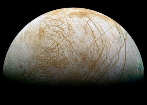 The darker-colored material within the fractures and elsewhere on Europa's surface might be sea salt brought up from the ocean below. Image Credit: NASA/JPL/Ted Stryk