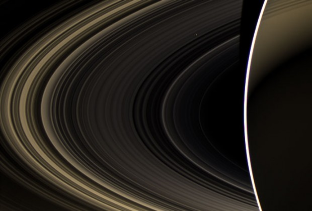 Cassini's view of Venus, as seen from Saturn. Venus is the bright speck shining through Saturn's rings, which are backlit by the sun in this image. Credit: NASA / JPL-Caltech / Space Science Institute