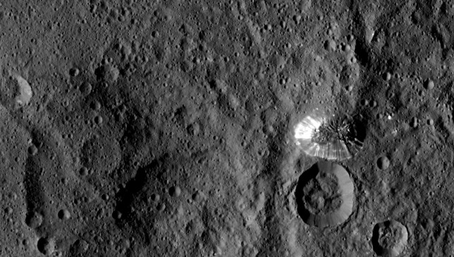 """The """"Lonely Mountain"""" on Ceres, which is about 4 miles (6 kilometers) tall. How did it form? Photo Credit: NASA/JPL-Caltech/UCLA/MPS/DLR/IDA"""