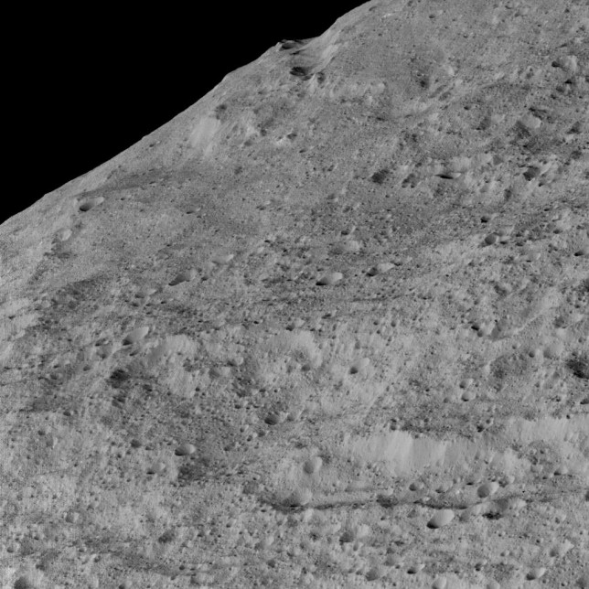 Another view, showing an area in the southern mid-latitudes of the dwarf planet. The location is near around a crater chain called Samhain Catena, at approximately 23.2 south latitude, 216.8 east longitude. Photo Credit: NASA/JPL-Caltech/UCLA/MPS/DLR/IDA
