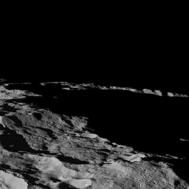 View of a region of Ceres in the southern hemisphere, with dramatic long shadows, at approximately 85.6 south longitude, 176.6 east longitude. Photo Credit: NASA/JPL-Caltech/UCLA/MPS/DLR/IDA