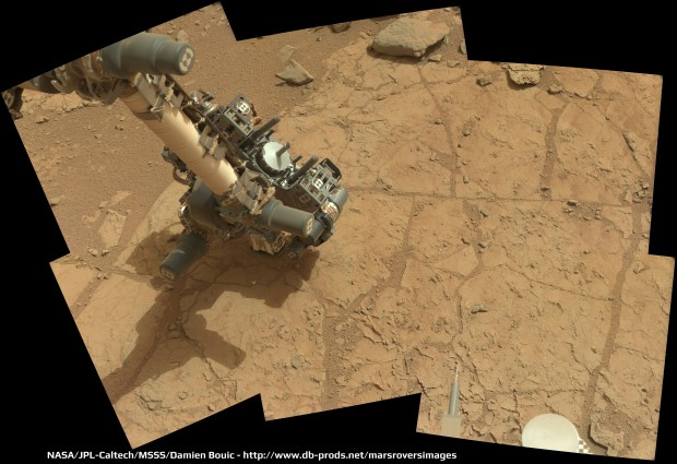 Curiosity inspects the bedrock slab called John Klein as it prepares for its first drilling test. Credit: NASA / JPL-Caltech / Damien Bouic