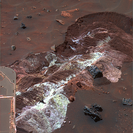 Salt deposits found by the Spirit rover as its broken wheel dragged in the sand; these salts can help keep water liquid in extreme cold. Photo Credit: NASA/JPL-Caltech