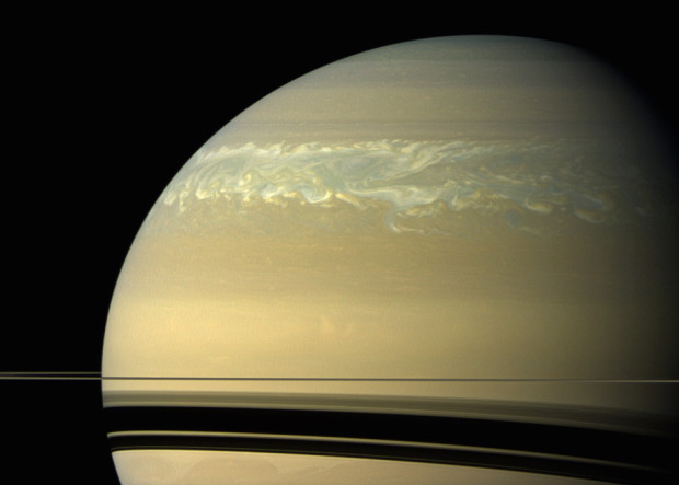 A giant storm in Saturn's northern hemisphere, which now extends around the planet, as seen by the Cassini spacecraft. Photo Credit: NASA/JPL-Caltech