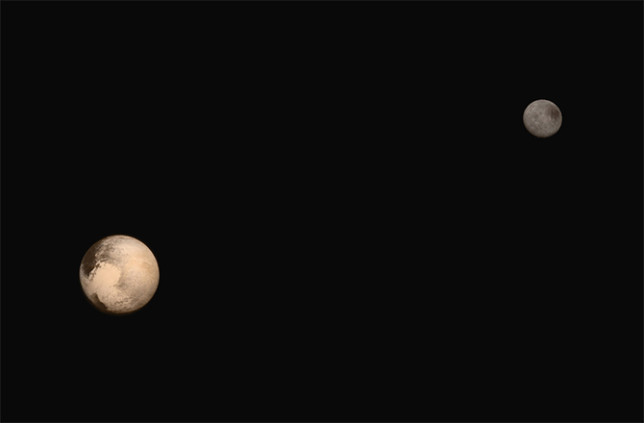 Pluto and its largest moon Charon. Photo Credit: NASA/JHUAPL/SWRI