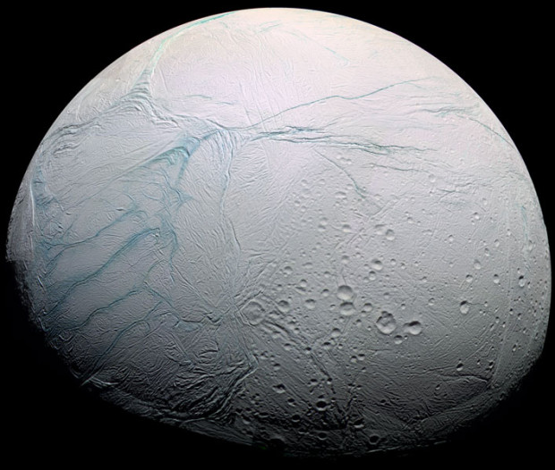 Enceladus, a tiny icy moon of Saturn, has a global ocean of water beneath its surface. The Tiger Stripe fissures, which the plumes erupt from, are visible on the left (actually the south pole). Image Credit: NASA/JPL-Caltech