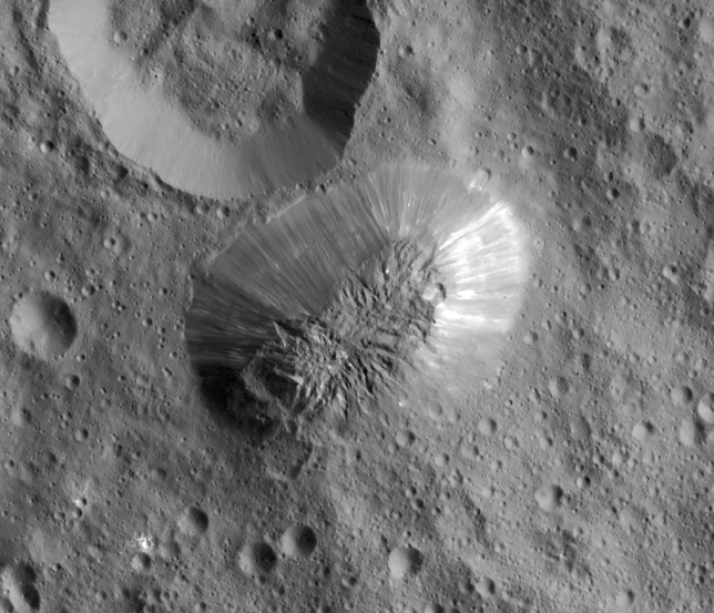 Closer view of Ahuna Mons and adjacent similar-sized crater. Photo Credit: NASA/JPL-Caltech/UCLA/MPS/DLR/IDA/PSI