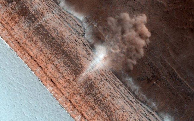 An avalanche caught in action on Mars, as seen by MRO. Photo Credit: NASA/JPL/University of Arizona