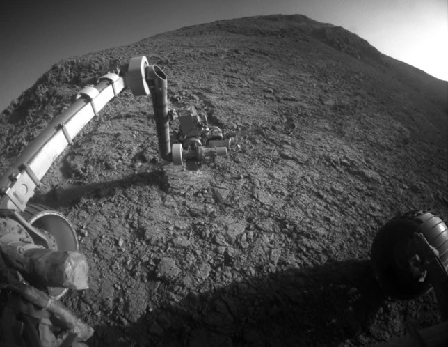 "Opportunity examining the rock outcrop called ""Private John Potts"" on the southern side of Marathon Valley. The rover has just passed its 12th anniversary milestone and is still going strong. Photo Credit: NASA/JPL-Caltech"