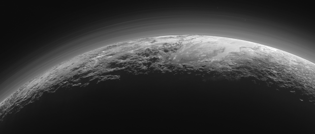 Stunning new panorama of Pluto backlit by the Sun, showing the icy plains, rugged mountains, and hazes in the atmosphere. The image was taken only 15 minutes after closest approach by New Horizons. Image Credit: NASA/JHUAPL/SwRI
