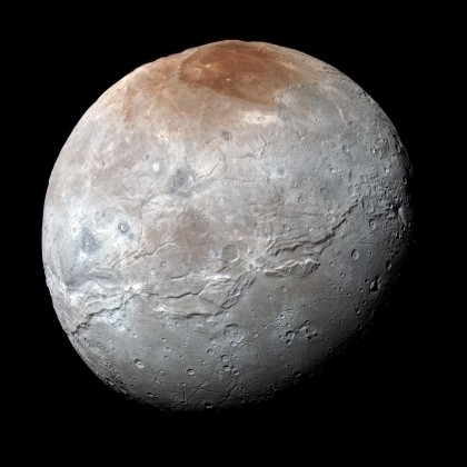 Pluto's largest moon Charon is also surprisingly active, with mountains and canyons. Photo Credit: NASA/JHUAPL/SwRI
