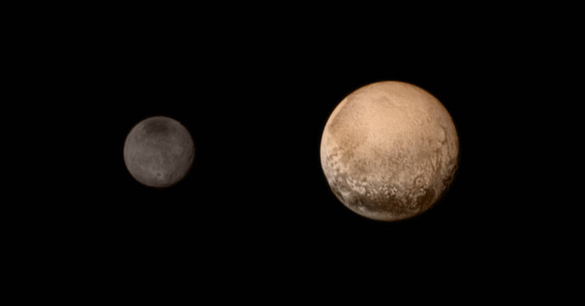 Pluto and Charon in colour, July 11, 2015. Image Credit: NASA/JHUAPL/SWRI