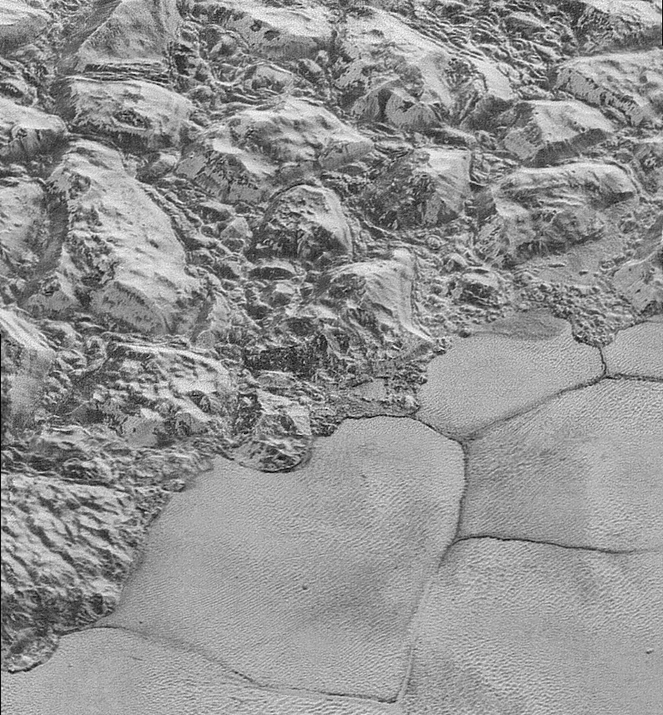 "Plutonian ""shoreline"": high-resolution image of Pluto from New Horizons, showing mountainous jumbled blocks in the water-ice crust, which border the smooth nitrogen-ice plains. Image Credit: NASA/JHUAPL/SwRI"