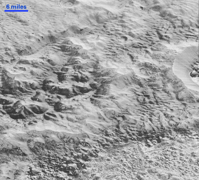 "The ""badlands"" on Pluto, showing evidence of erosion and faulting. Image Credit: NASA/JHUAPL/SwRI"
