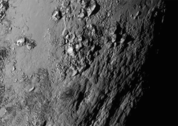 The icy mountains of Pluto. Photo Credit: NASA/Johns Hopkins University Applied Physics Laboratory/Southwest Research Institute