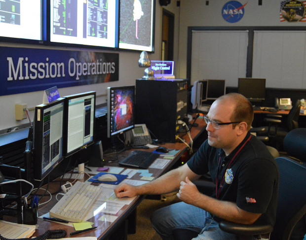 Flight controller George Lawrence monitors data from New Horizons at the New Horizons Mission Operations Center at the Johns Hopkins University Applied Physics Laboratory on Nov. 4, 2015. Image Credit: NASA/JHUAPL/SwRI