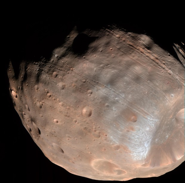Another good view of both the grooves and the heavily cratered surface of Phobos. Image Credit: NASA/JPL-Caltech/University of Arizona