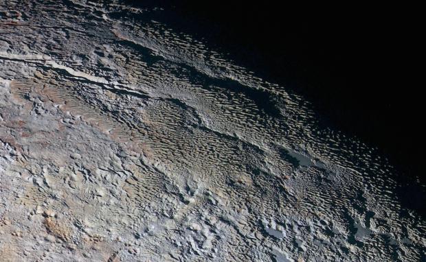 "The ""snakeskin"" terrain in the Tartarus Dorsa region on Pluto. Image Credit: NASA/JHUAPL/SWRI"