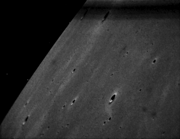The final image of the Moon taken by LADEE, on Feb. 8, 2014. The photo shows craters Lichtenberg A and Schiaparelli E in the smooth mare basalt plains of Western Oceanus Procellarum, west of the Aristarchus plateau. Photo Credit: NASA Ames